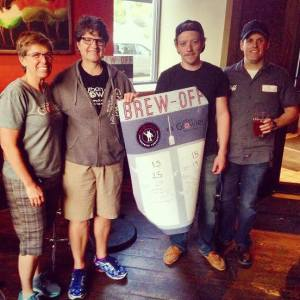 From left: Urban Growler's Jill Pavlak and head brewer Deb Loch stand next to Brew-Off hosts Derek Brown and head brewer Jeff Moriarty.