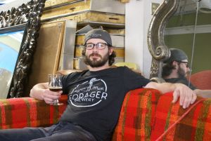 Forager head brewer Austin Jevne sips on a Flanders red he made.